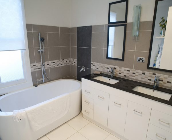 interor of a modern style bathroom with bath and sinks
